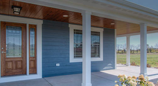 Home design with wrap around prairie porch with stunning entrance in Whitewater